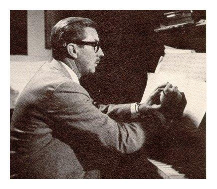 David Van Vactor at the piano composing